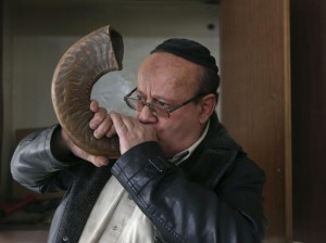 Zabulon Simantov, an Afghan Jew, blows the traditional shofar, or ram's horn, at a synagogue in Kabul