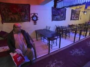 Zabulon Simantov, an Afghan Jew, sits inside his cafe in Kabul