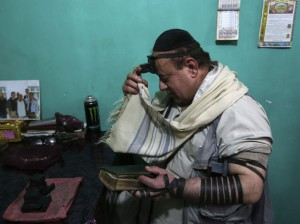 Simantov, an Afghan Jew, prays at his residence in Kabul